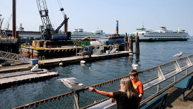 Construction crews work on new pilings to support a temporary passenger-only ferry facility at Colman Dock. Fast ferry service will continue to run as normal next week due to delays in construction to the dock.