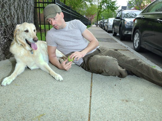 """Benoit Denizet-Lewis, author of """"Travels with Casey,"""" takes a break with his dog Casey on May 13 outside a park near his home in Jamaica Plain, Mass.  Denizet-Lewis crafted his novel a la Steinbeck's """"Travels With Charley."""""""