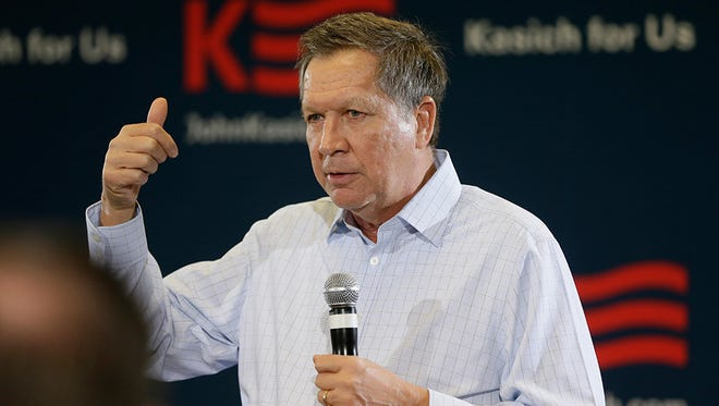 Republican presidential candidate, Ohio Gov. John Kasich, addresses supporters during a town hall meeting in Livonia, Mich.