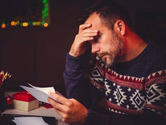 Worried Men cheeking his mail late night