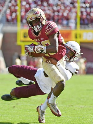 Dec 2, 2017; Tallahassee, FL, USA; Florida State Seminoles wide receiver DJ Matthews (29) scores a touchdown past Louisiana Monroe Warhawks cornerback Marcus Hubbard (9) during the first half at Doak Campbell Stadium. Mandatory Credit: Melina Vastola-USA TODAY Sports