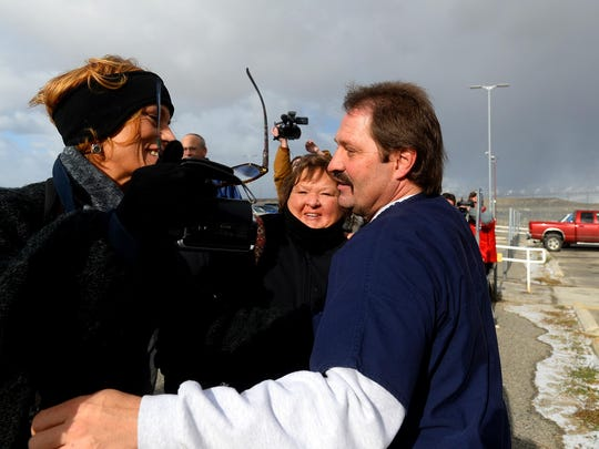 Barry Beach hugs supporters after addressing the media
