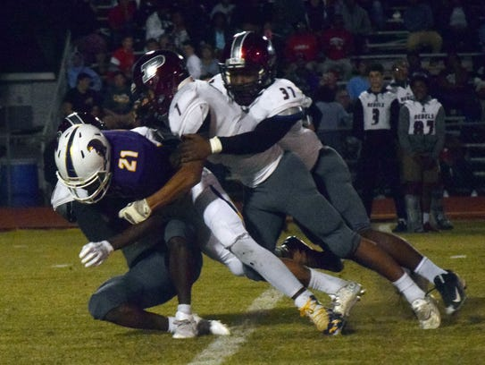 Pineville defenders Mikinzi Nash (7, center) and Amad
