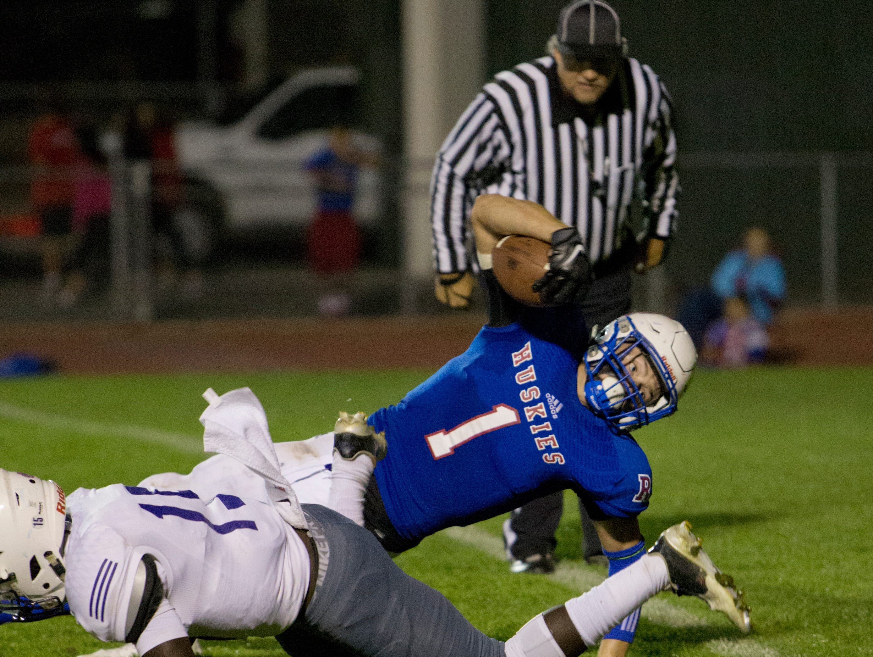 Reno Huskies quarterback Isaac Terrasas dives into the endzone for a touchdown in the second quarter against Spanish Springs Cougars during their football game played on Friday, October 16, 2015 at Reno High School in Reno, Nevada.