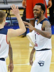University of Southern Indiana guard Alex Stein (20) high fives Eagles' teammate Jeril Taylor (1) after their 88-71 win over William Jewell  at USI's PAC Center on  Jan. 5.