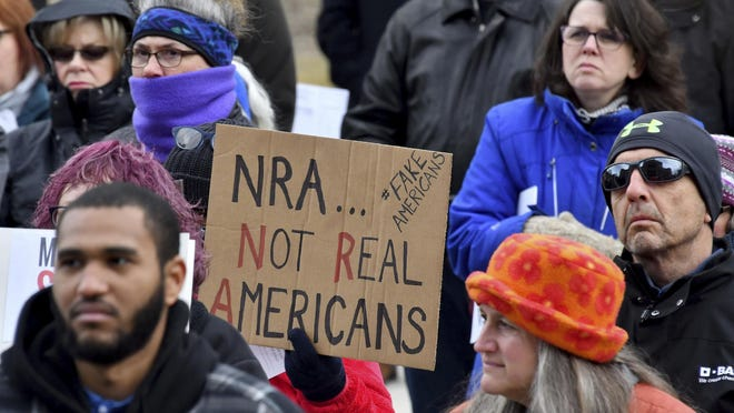In February 2018, people at a rally in Lansing call for the passage of gun control legislation in Michigan.