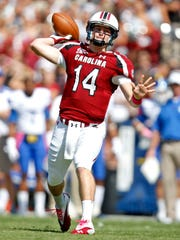 South Carolina quarterback Connor Shaw throws a pass
