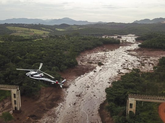 Aerial view mud-hit area in Corrego do Feijao near the town of Brumadinho in the state of Minas Gerias in southeastern Brazil, on January 26, 2019 a day after the collapse of a dam at an iron-ore mine belonging to Brazil's giant mining company Vale.