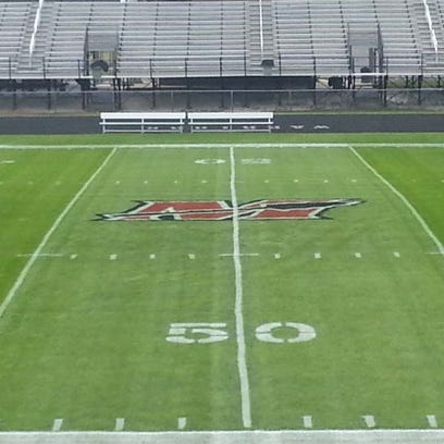 Muskego High School football field with a logo/layout on the field.