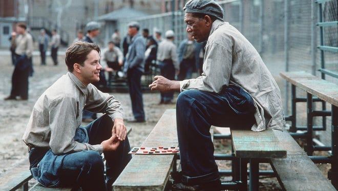 "Tim Robbins (left) and Morgan Freeman star in ""The Shawshank Redemption."""