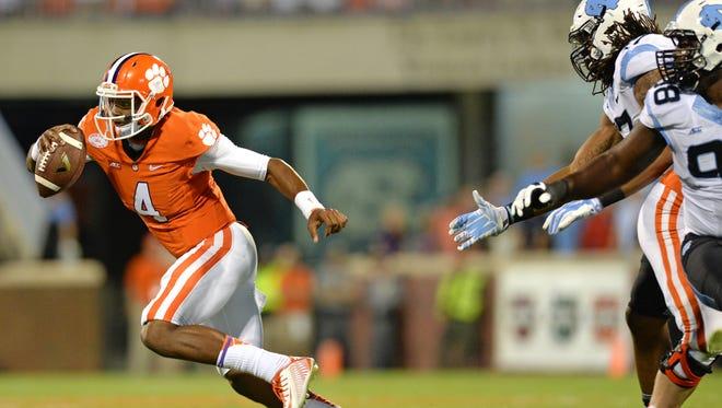 Clemson quarterback Deshaun Watson (4) scrambles out of the pocket against North Carolina during the 1st quarter Saturday, September 27, 2014 at Clemson's Memorial Stadium.