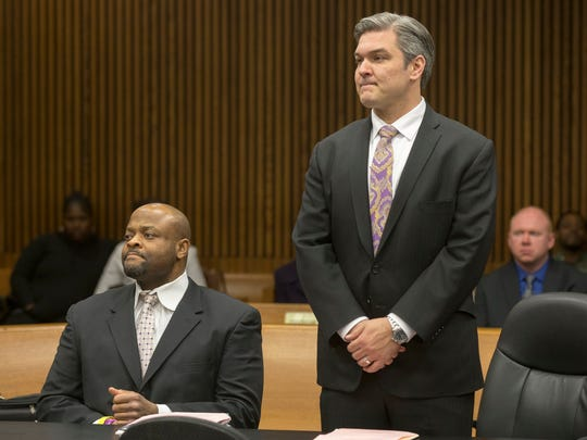 Kevin Beverly, 45, left, sits next to his attorney, Paul Tylenda, at Frank Murphy Hall of Justice on Monday, March 19, 2018, in Detroit.