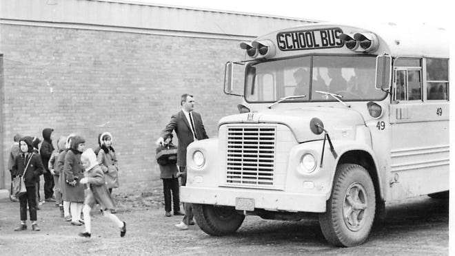 Gates Chili Central School District opening day of school in December 1967. The gentleman pictured with the bus is the school's first principal, Jack Story.