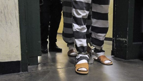 Inmates enter the Minnehaha County Jail in Sioux Falls,