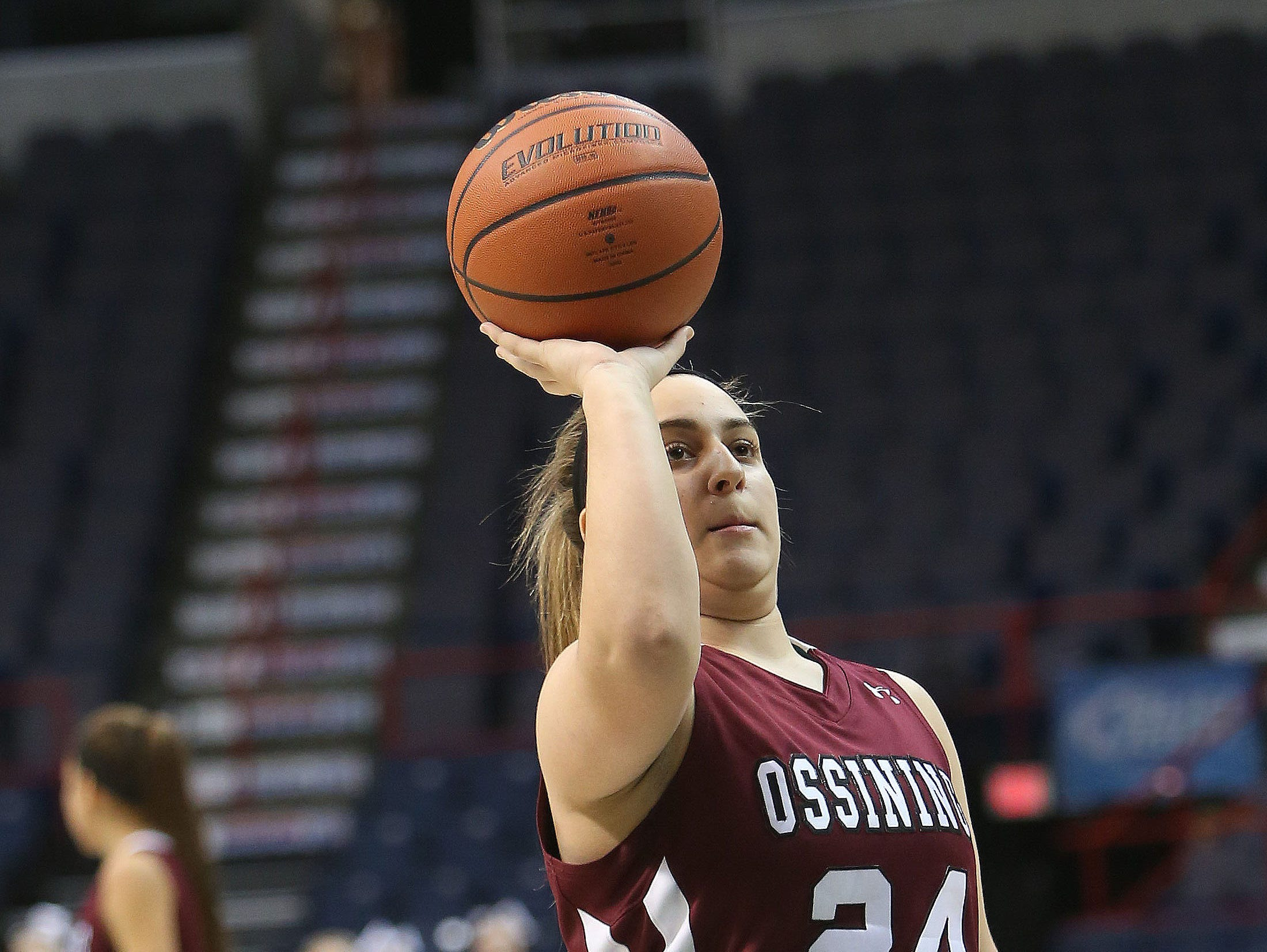 Ossining senior Sam Cozzolino shoots a one-handed free throw in the girls Class AA final of the New York State Federation Tournament of Champions at the Times Union Center in Albany March 19, 2016.