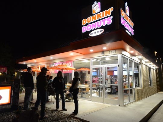 Customers wait outside Dunkin Donuts before it opened in Fort Collins in 2014.
