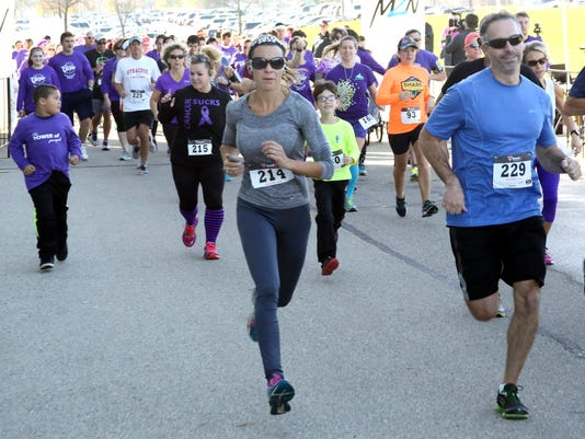 Runners at the start of the Power of Purple 5K run at Menomonee Falls High School on Nov. 5.