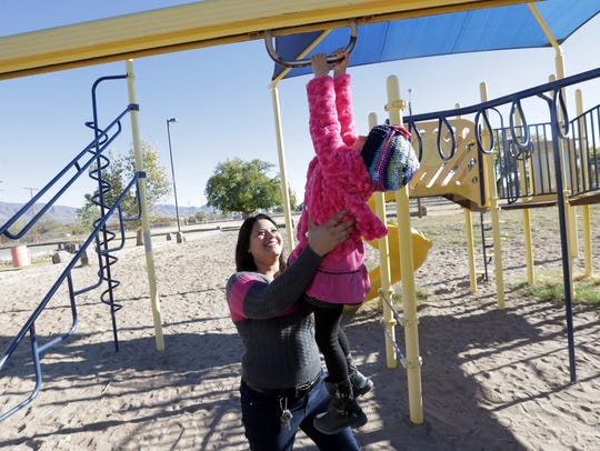 Jaime Morales plays with her daughter, Ariel, 4, on
