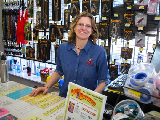 Virginia Wiley, granddaughter of the founders of Hayden's Hardware, behind the counter of the store she's owned for almost 8 years.