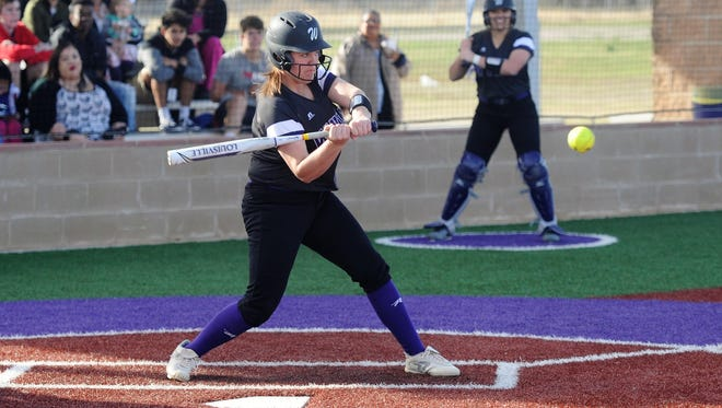 Wylie's Bailey Buck (17) takes a swing during the Lady Bulldogs' 8-7 win against Clyde on Tuesday, March 6, 2018.