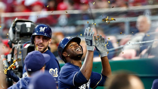 Brewers centerfielder Lorenzo Cain is showered with confetti after hitting a two-run home run during the fifth inning at Great American Ball Park.