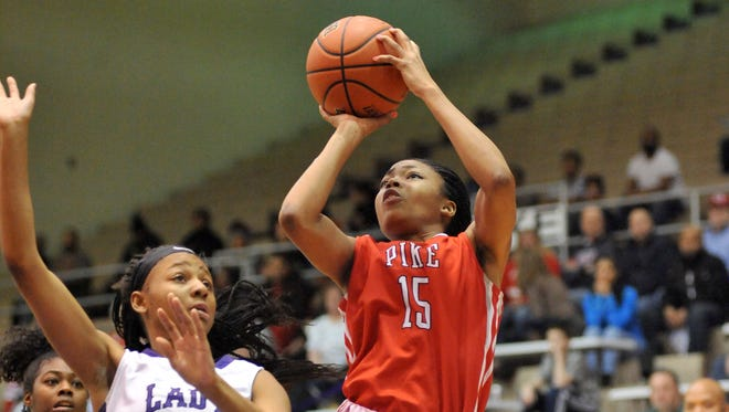 Pike's Angela Baker rises up for a shot during the Red Devils' 58-55 sectional championship win over Geniya Petty and Ben Davis on Saturday night in Indianapolis.