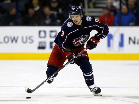 FILE - In this Dec. 11, 2018, file photo, Columbus Blue Jackets forward Artemi Panarin carries the puck against the Vancouver Canucks during an NHL hockey game, in Columbus, Ohio. Panarin, the top free agent available this offseason, signed a seven-year, $81.5 million deal to join the New York Rangers. (AP Photo/Paul Vernon, File)