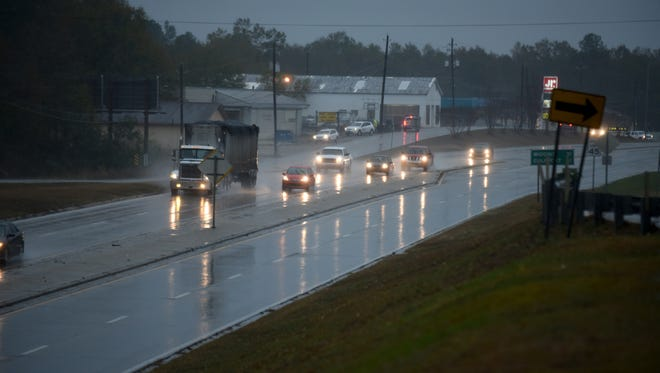 Vehicles drive through the rain on U.S. 49 as severe weather pass through the Pine Belt Wednesday.