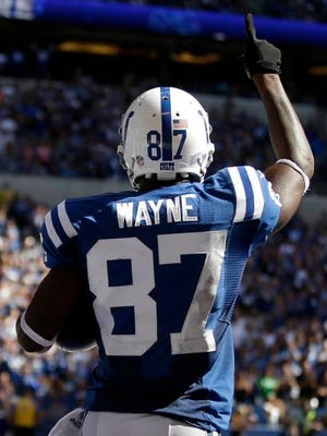 Colts wide receiver Reggie Wayne celebrates a touchdown against the Titans during the second half.