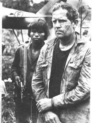 Eugene Hasenfus is shown after the crash of a plane carrying cargo to contra rebels that was shot down by government forces. This AP photo is from 1986.