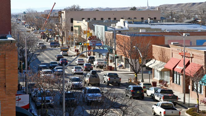 Traffic moves Feb. 5 along Main Street in downtown Farmington. Part of a plan to make the district more pedestrian and bicycle friendly has been approved by the City Council.