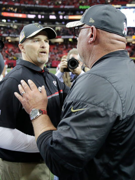 Atlanta Falcons head coach Dan Quinn, left, speaks with Arizona Cardinals head coach Bruce Arians after an NFL football game, Sunday, Nov. 27, 2016, in Atlanta. The Falcons won 38-19. (AP Photo/David Goldman)