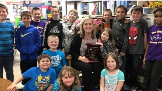 Two Rivers Teacher of the Year Mary Basken with her third-grade class from Koenig Elementary School.