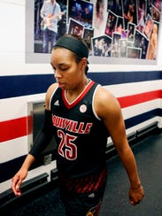 Louisville's Asia Durr walks back to the locker room