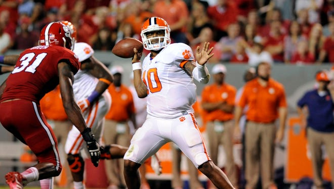 Clemson Tigers quarterback Tajh Boyd (10) throws against the North Carolina State Wolfpack at Carter Finley Stadium.
