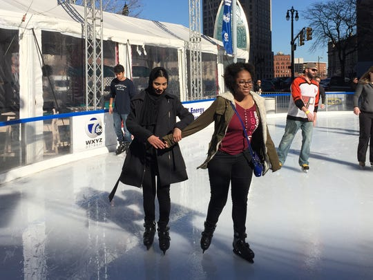 Ayesha Helal, 15, of Hamtramck, left, and Miah Caine,