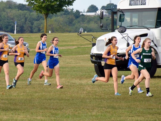 Runners from Waynesboro, Robert E. Lee and Broadway head out to the course at the start of the girls race at the Valley District mini-meet at the Rockingham County Fairgrounds in Harrisonburg, Va., on Wednesday, Sept. 21, 2016.