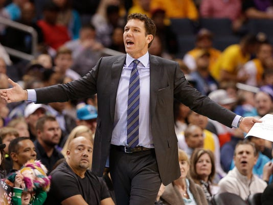 Los Angeles Lakers head coach Luke Walton reacts to a call during the first half of an NBA basketball game against the Charlotte Hornets in Charlotte, N.C., Saturday, Dec. 9, 2017. Walton was called for a technical foul during the exchange. (AP Photo/Chuck Burton)