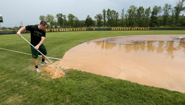 The scene at a muddy College at Brockport softball field on Friday afternoon.