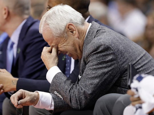 North Carolina head coach Roy Williams lreacts on the bench during the second half of a second-round game against Texas A&M in the NCAA men's college basketball tournament in Charlotte, N.C., Sunday, March 18, 2018. (AP Photo/Gerry Broome)