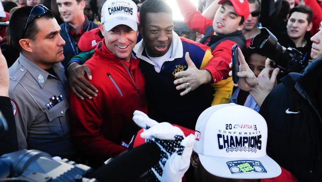 Dec 5, 2015; Bowling Green, KY, USA; Western Kentucky Hilltoppers head coach Jeff Brohm celebrates with fans after the Conference USA football championship game against Southern Miss Golden Eagles at Houchens Industries-L.T. Smith Stadium. Western Kentucky Hilltoppers won 45-28. Mandatory Credit: Joshua Lindsey-USA TODAY Sports