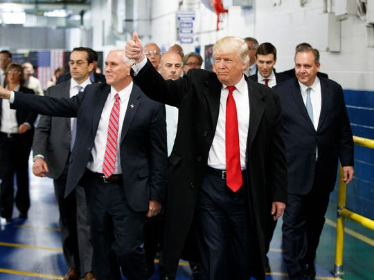 In this Dec. 1, 2016, file photo, President-elect Donald Trump and Vice President-elect Mike Pence wave as they visit to Carrier factory in Indianapolis, Ind. Donald Trump enters the White House on Jan. 20 just as he entered the race for president: defiant, unfiltered, unbound by tradition and utterly confident in his chosen course. In the 10 weeks since his surprise election as the nation's 45th president, Trump has violated decades of established diplomatic protocol, sent shockwaves through business boardrooms, tested long-standing ethics rules and continued his combative style of replying to any slight with a personal attack _ on Twitter and in person.