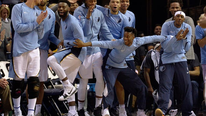 Memphis Grizzlies players react from the bench in the second half of a game against the Golden State Warriors on Saturday, Oct. 21, 2017, in Memphis. The Grizzlies won 111-101.