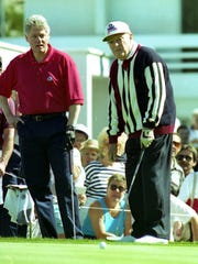 President Bill Clinton and Bob Hope watch Hope's putt during the 1995 Bob Hope Chrysler Classic.