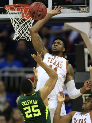 Texas center Prince Ibeh (44) blocks a shot by Baylor guard Al Freeman (25) during the second half of an NCAA college basketball game in the quarterfinals of the Big 12 conference tournament in Kansas City, Mo., Thursday, March 10, 2016. Baylor defeated Texas 75-61. (AP Photo/Orlin Wagner)