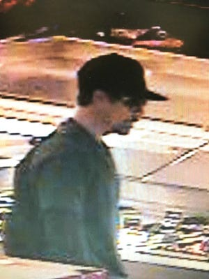 A security photo shows a man South Lake Tahoe police believe poured an unknown substance on the food at the self-serve food court at Raley's.