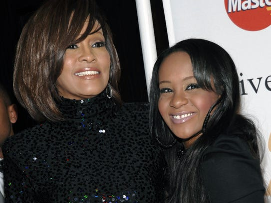 Whitney Houston (left) and her daughter, Bobbi Kristina