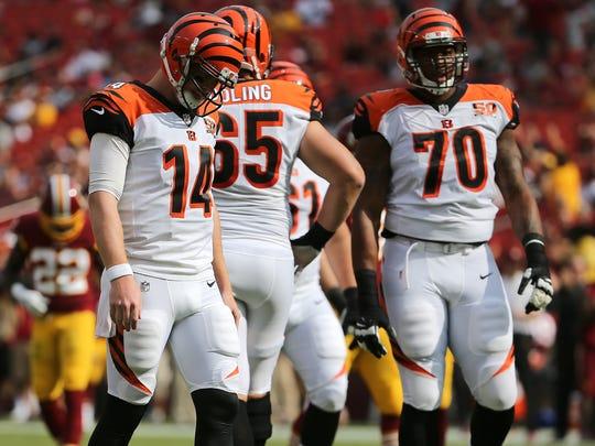 Cincinnati Bengals quarterback Andy Dalton (14), left,