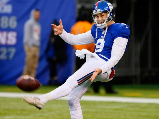 New York Giants punter Brad Wing (9) during warms up