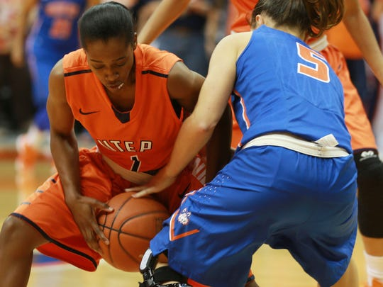 UTEP'S Starr Breedlove steals the ball from Houston Baptist's Lisa Zderadicka during the first quarter Sunday.